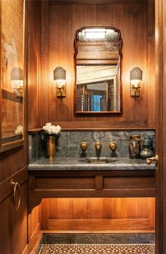 The Warmth of Wood - Design Chic  Love this!  stone, faucet and vase, wood paneling, brass towel ring, mirror shape, lighting below vanity