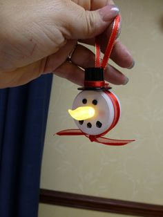 Snowman ornament made from a battery operated tea light! soooooo cute!