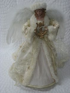 Angel Christmas Tree Topper, White & Gold. www.kathysholiday.com
