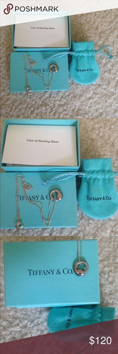 Tiffany & Co Elsa Peretti Sterling Silver necklac Authentic Tiffany and Company Elsa Perretti sterling silver 925 pendant with 16 inch chain. Given to me as a gift but I can't wear sterling silver. It's brand new never been worn Tiffany & Co. Jewelry