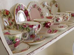 This shelf of teacups and saucers reminds me staying with my Great Uncle when I little..that's where the teacup obsession began.. ;o)