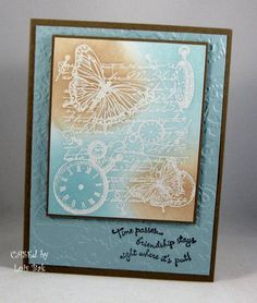After embossing the image with white detail embossing powder, crafter sponged distress inks over the entire image.