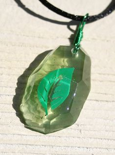 Hey, I found this really awesome Etsy listing at https://www.etsy.com/listing/161671073/pokemon-leaf-stone-evolution-necklace