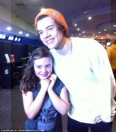 Dream come true: A young fan looks like all her Christmases came in one as she got a snap with the boybander