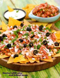 Nachos with Salsa and Baked Beans, with uncooked salsa, baked beans and a creamy cheese sauce arranged temptingly atop corn chips, it causes a burst of flavours and textures in your mouth. Vegetarian Mexican Recipes, Veg Recipes, Mexican Food Recipes, Cooking Recipes, Starter Recipes, Online Recipes, Vegetarian Cooking, Healthy Recipes, Side Dishes