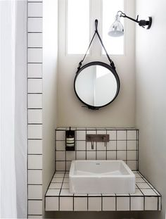 White tiles + black grout | bathrooms. A VERY SMALL STUDIO APARTMENT IN FRANCE | THE STYLE FILES