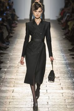 "For fall 17, Bottega Veneta opted for 1940s Hollywood glamour, with a strictly formal collection for both men and women. ""The men's and the women's complement each other. They wer…"