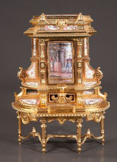 "French bronze ormolu miniature vitrine with porcelain plaques with garden scenes and figural decoration, center bevelled edge door, above a small filigree drawer, c.1900, 10"" wide, 4"" deep, 13"" high"