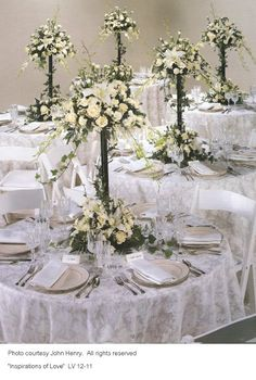 Wedding Flower Centerpieces | This lovely arrangement is made primarily with white roses and Casa ...