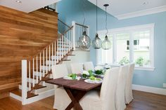 contemporary cape cod - great shot of blue and planked wall along the stairway.