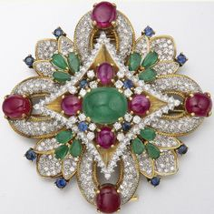 18K GOLD, EMERALD, RUBY, DIAMOND AND SAPPHIRE PENDANT-BROOCH Numerous diamonds approx 8.50 cts.