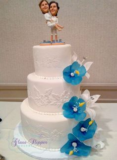 fondant wedding cake with stenciled  flower decor and edible wafer paper flowers