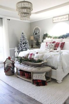 Gorgeous white Christmas tree with tartan blankets and pillows.