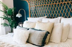 A mix of pillows and shams in shades of white and cream feel cozy and plush while still keeping things light.