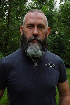 Sporting a good cut and a full beard