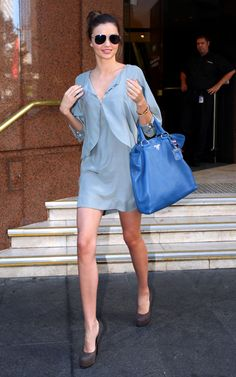 Miranda Kerr and her blue Prada bag.