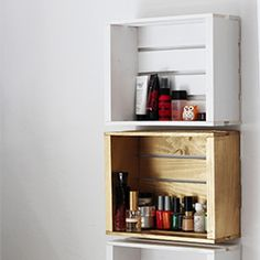 Simple and inexpensive shelving made from wood crates found at any craft store.