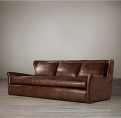 RH's 7' Belgian Wingback Leather Sofa:Our European-inspired take on a classic style redefines it for a new age. Low to the ground, deep in profile, and sleekly streamlined for casual yet sophisticated appeal, it's a chic, ultra-comfortable twist on tradition.