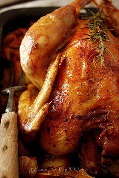 Roast chicken with potatoes, garlic and rosemary.