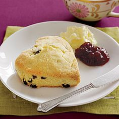Old-Fashioned Cream Scones 2 cups  cake flour    1/4 cup  sugar, plus 1 Tbsp. for sprinkling    1 1/2 teaspoons  baking powder    1/2 teaspoon  salt    6 tablespoons  cold unsalted butter, cut into bits    1/2 cup  dried currants    2/3 cup  heavy cream, plus    1 tablespoon  for brushing    2   egg yolks