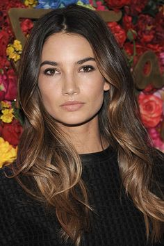 Brunette shades look more interesting when layered with ultra-thin ribbons of blonde around the face. As seen on: Lily Aldridge Getty  - HarpersBAZAAR.com