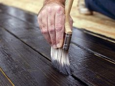 Application of decking stain on new decking boards