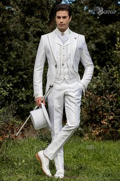 Baroque white brocade frock coat with peak lapels and crystal rhinestones and crystal brooch. Men's Tuxedo Wedding, White Wedding Suit, Wedding Men, Wedding Suits, Wedding Attire, Wedding Groom, Best Mens Fashion, Mens Fashion Suits, Mens Suits