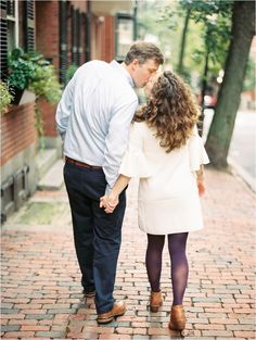 Couple kissing while walking in Beacon Hill Boston MA | Destination wedding photographer Catherine Ann Photography | Kodak Portra 400