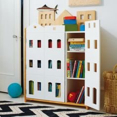 Brownstone Bookcase from land of Nod--love that my son could play with his action figures with it too!