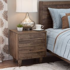 Add storage and style to your bedroom motif with this handsome 2-drawer Venetian nightstand. Featuring a rustic natural burn finish with a slat design and solid rubberwood construction, this nightstand is perfect for all your bedtime essentials.