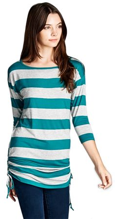 String it Along Top It's all about stripes with this cute tunic. Adjustable drawstring detail on the sides lets you create the perfect length and look for your figure. Dropped shoulder and 3/4 length sleeves keep it casual. Choose graphic black and ivory or subtle heather grey and teal.  3/4 length sleeve Drawstring detail on the sides Tunic length Slight boat neck