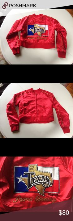 """Vintage red bomber jacket Texas long sleeves hip Omg you guys this is the coolest jacket ever! It is Vintage circa 1981 from the Billy Bob ft worth Texas honky tonk. The back has a gorgeous embroidery of the state of Texas over the state flag. It reads """"Billy bobs Texas ft worth grand opening"""". Such an amazing piece to add to your street wear wardrobe. Don't miss it! Base is red satin. Minor pulls and small pen stainzipper paint a bit chipped. Gold pin stripes on the sleeves. Zipper front…"""