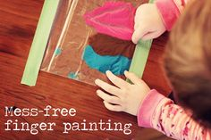 #kidcrafts, Mess-Free Finger Painting — paint + plastic zip bag + painters tape = at least 30 minutes of quiet!
