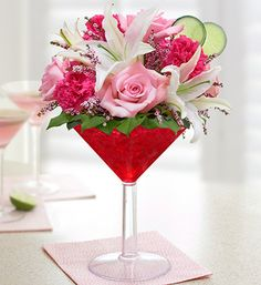 Cosmopolitan Bouquet™- pink roses, white lilies, carnations, calcynia and salal $39.99- $69.99