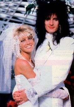 one of the ultimate rocker babes of the one and only heather locklear. every girl wanted to look like and be her.esp when she was with tommy lee (that was way before pamela). Star Wedding, Wedding Pics, Wedding Couples, Wedding Styles, Wedding Shot, Celebrity Wedding Photos, Celebrity Couples, Celebrity Weddings, Heather Locklear
