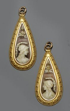 Shell cameo earrings carved to depict Athena, Greek goddess of was with rope twist and wirework decorated mount.