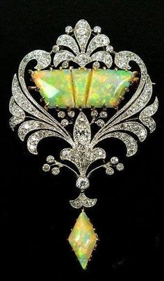 An early century diamond and opal set brooch designed as a three panel opal centre within old cut diamond set openwork scroll border all supporting opal drop all claw collet and pave set in yellow and white metal the reverse with detachable brooch. Opal Jewelry, Jewelry Art, Antique Jewelry, Vintage Jewelry, Fine Jewelry, Jewelry Design, Jewellery Box, Jewellery 2017, Edwardian Jewelry