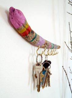 Painted driftwood key holder, or jewelry organizer rack. Cool idea!