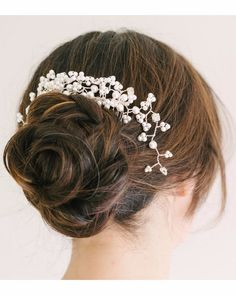 Not a fan of necklaces, you can wear your classic pearls in your hair with this SimplyFayeTiaras bridal comb from Etsy!