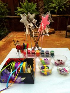 Fairy Crafts - Make your own wand (foam stars on sticks prepped ahead of time). All stickers, ribbons and foam markers were from clearance bin. Total cost for 10 guests to do this craft was 18 dollars!)