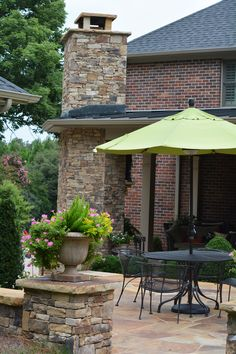 Porch addition w/ outdoor fireplace using flagstone paving and stacked stone walls.
