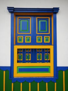 Blue window in Salento (colombia) by Availi on Gate Decoration, Mexican Colors, Ethnic Home Decor, Unique Doors, Window Frames, Garden Gates, Wall Colors, Windows And Doors, Bunt