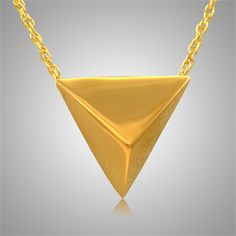 The Pyramid Keepsake Cremation Pendant is 14k Yellow Gold and crafted by an artistic skilled jeweler one at a time. The quality is excellent and the craftsmanship is outstanding. This Keepsake Pendant holds a small amount of remains, a piece of hair or something that is small enough to memorialize your loved one and bring them close to your heart.