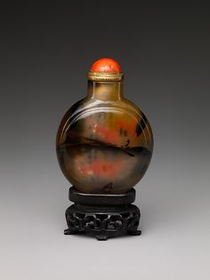 Snuff Bottle  Period: Qing dynasty (1644–1911), Qianlong period (1736–95)  Culture: China Medium: Murrhina agate with coral stopper