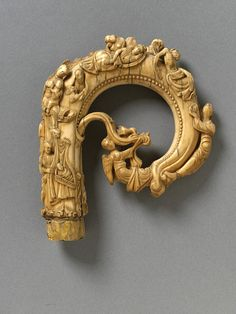 The Saint Nicholas Crozier. Carved Ivory. Right Side. Ile-de-France, France. Circa 1160. 11.7cm x 10.5cm x 2.7cm. The Crozier's Carving shows three scenes from the Life of St Nicholas, the Agnus Dei (The Lamb of God), the Nativity of Christ and the Annunciation to the Shepherds. Saint Nicholas (270-343) was a Beloved Greek Saint Known for his Secret Gift Giving. Victoria and Albert Museum, London, England.