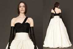 This is a dress with attitude. The ivory and black one-shoulder gown has hand-wrapped detail at the bodice and hand-draped accents on the skirt