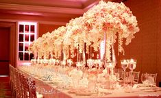 Opulent wedding reception in neutral and pink color palette at the Four Seasons Maui Ballroom