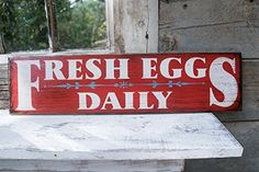 """Farmhouse Fresh Eggs Daily Sign. FRESH EGGS DAILY sign. Do your hens work as hard for you as ours do for us?! We are new to backyard chickens and we love every single girl!! Hand painted, hand weathered, and polyurethaned for outdoor use. We work very hard on these signs to make each a custom art piece for your home or man cave or office! These signs measure 24"""" wide by 6"""" tall. Perfect for the office, kitchen, chicken coop, chicken run, or anywhere in your home! We love our chickens and…"""