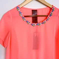 Moon Collection Jewel Neck Embellished Top NWT Gorgeous peach top by Moon Collection. Jewel embellished neckline. Loose peplum accent. Perfect for spring!  {{color most accurate in image 1, though colors may appear different on different screens}}  No trades! Thank you! Moon Collection Tops Blouses