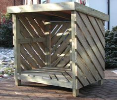 Firewood shelter and storage made from recycled pallet boards.